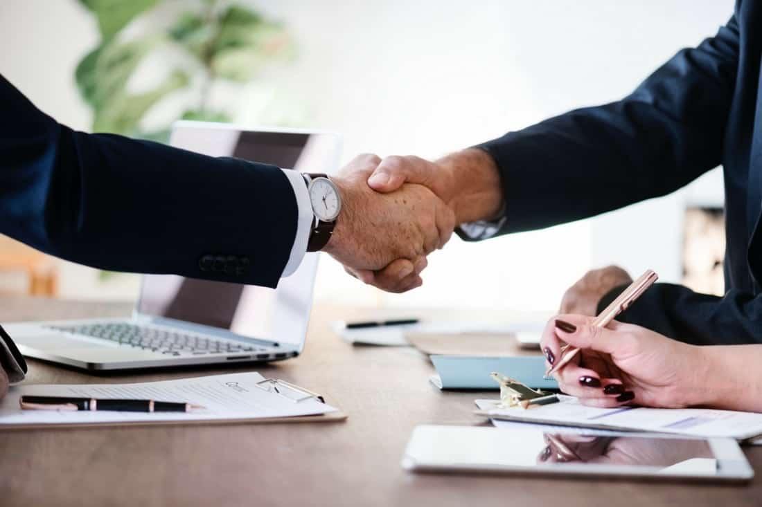 loan broker - hands shaking across a business desk