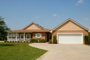 Front of an executive style suburban house with nice lawn and double garage